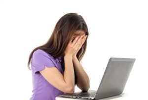 girl at a computer with hands to face troubleshooting ninja forms email